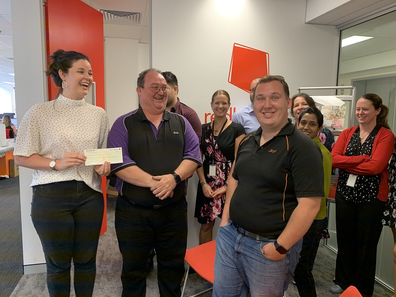Handing over the $2500 to Redkite for our fundraising in 2019